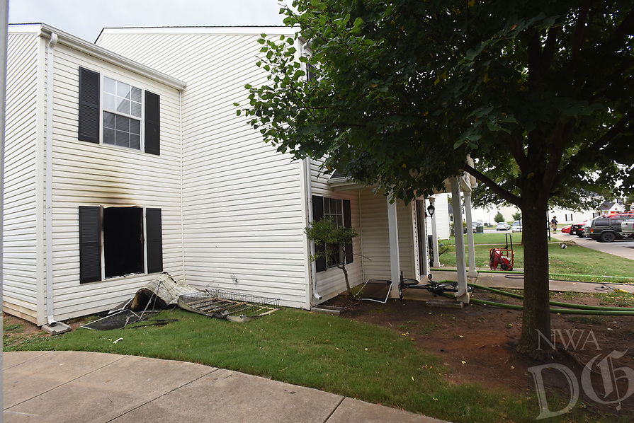 NWA Democrat-Gazette/FLIP PUTTHOFF <br />BENTONVILLE APARTMENT FIRE<br />Damage is seen Tuesday Aug. 7 2018 after a fire at Ashton Heights Apartments, 1002 S.E. Finch Lane, Building 44. Four families are displaced by the fire that started about 9:30 a.m. A cause has not been determined, Bentonville fire officials said. A child was initially reported as missing but was found unharmed later.