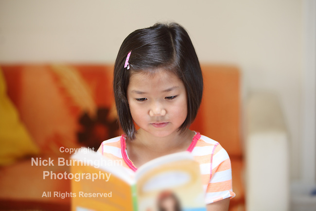 Young Chinese girl reading a book EXCLUSIVE TO THIS SITE