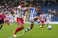 Fraser Franks of Stevenage and Sammie Szmodics of Colchester United during Colchester United vs Stevenage, Sky Bet EFL League 2 Football at the Weston Homes Community Stadium on 12th August 2017