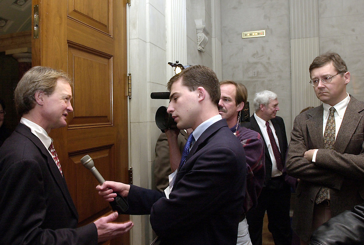 1oil020702 -- Senator Lincoln Chafee (R-RI) talks to a reporters after crossing party lines and declaring that he doen't support arctic refuge drilling in Alaska.