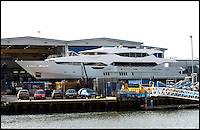 BNPS.co.uk (01202) 558833<br /> Picture: LauraJones/BNPS<br /> <br /> Former Formula 1 team owner Eddie Jordan's custom-made yacht.<br /> <br /> A precious cargo of luxury motorboats worth &pound;25 million are loaded onto an enormous cargo ship for a piggy-back ride to their new wealthy Mediterranean owners.<br /> <br /> Seven plush powerboats made by Sunseeker carefully craned onto a special 300ft transporter ship at the company's boatyard in Poole, Dorset.<br /> <br /> The boats are destined for a number of undisclosed millionaire's resorts around the Mediterranean.<br /> <br /> Included in the shipment were two Sunseeker 28 Metre Yachts each worth &pound;6 million plus one Predator 115 which sells for &pound;11 million.<br /> <br /> It comes weeks after the firm unveiled the biggest boat ever built in the UK - a whopping 155ft superyacht made for Formula One mogul Eddie Jordan for an estimated &pound;32 million.