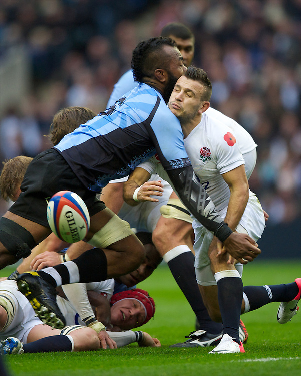 Danny Care of England is tackled by Api Naikatini of the Flying Fijians during the QBE International between England and Fiji at Twickenham on Saturday 10th November 2012 (Photo by Rob Munro)