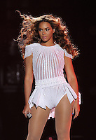 """Singer Beyonce performs on the opening night of her """"Mrs. Carter Show World Tour 2013"""", on Monday, April 15, 2013 at the Kombank Arena in Belgrade, Serbia. Beyonce is wearing a custom, hand beaded white peplum one-piece by designers Ralph & Russo. (Photo by Frank Micelotta/Invision for Parkwood Entertainment/AP Images)"""