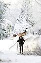 Eoin O'Coisneachain heads to the shops with his skies following a heavy snow fall near Lisburn, County Antrim, Friday, December 8th, 2017. Photo/Paul McErlane