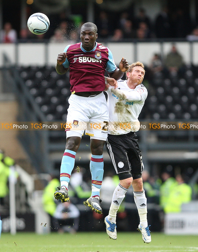 Paul Green of Derby and Papa Bouba Diop of West Ham - Derby County vs West Ham United, npower Championship at Pride Park, Derby - 31/12/11 - MANDATORY CREDIT: Rob Newell/TGSPHOTO - Self billing applies where appropriate - 0845 094 6026 - contact@tgsphoto.co.uk - NO UNPAID USE.