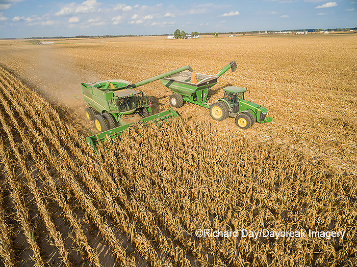 63801-08302 Corn Harvest, John Deere combine unloading corn into grain cart while harvesting - aerial Marion Co. IL