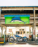 USA, Florida, motorcycle and marlin at a fishing marina, Islamorada
