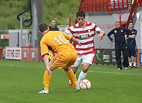 Stephen Hendrie takes on Robert McHugh in the Hamilton Academical v Motherwell friendly match played at New Douglas Park, Hamilton on 24.7.12..