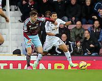 Sunday 07 December 2014<br /> Pictured L-R: Carl Jenkinson of West Ham is challenging Jefferson Montero of Swansea <br /> Re: Premier League West Ham United v Swansea City FC at Boleyn Ground, London, UK.