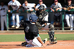 28 May 2016: Nova Southeastern's Michael Hernandez (6) is tagged out at home plate by Franklin Pierce's Stephen Octave. The Nova Southeastern University Sharks played the Franklin Pierce University Ravens in Game 3 of the 2016 NCAA Division II College World Series  at Coleman Field at the USA Baseball National Training Complex in Cary, North Carolina. Nova Southeastern won the game 4-3 in twelve innings.