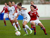 USWNT midfielder (10) Carli Lloyd sprints past Denmark's (11) Merete Pedersen during the opening match of the Algarve Cup.  The USWNT defeated Denmark, 2-0, in Lagos, Portugal.