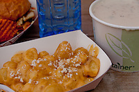 Lightly deep fried gnocchi with a spicy cheddar cheese sauce from The Lime Truck (http://www.thelimetruck.com/lime/Home.html), a bowl of clam chowder from the Lobsta Truck (http://www.lobstatruck.com/), and a tofu burger with homemade root vegetable chips from Chomp Comp (http://www.chompchompnation.com/).  And a blue water bottle, too.