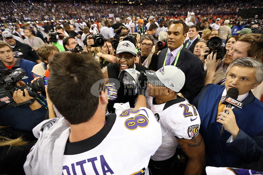 Feb 3, 2013; New Orleans, LA, USA; Baltimore Ravens inside linebacker Ray Lewis (middle) celebrates with teammates Dennis Pitta (88) and Ray Rice (27) after defeating the San Francisco 49ers in Super Bowl XLVII at the Mercedes-Benz Superdome. Mandatory Credit: Mark J. Rebilas-