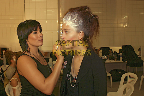 MODEL.Backstage at the Vivienne Westwood ready to wear Spring/Summer Collection 2005, Paris, France, .October 5th 2004..portrait headshot fashion show make-up artist.Ref: MDS.www.capitalpictures.com.sales@capitalpictures.com.©O.Medias/Capital Pictures .