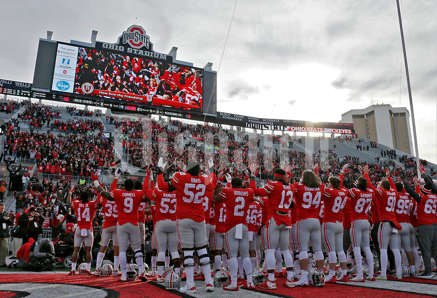 "The Ohio State Buckeyes sing ""Carmen Ohio"" following a 48-3 win over the Michigan State Spartans during Saturday's NCAA Division I football game at Ohio Stadium in Columbus on November 11, 2017. [Barbara J. Perenic/Dispatch]"