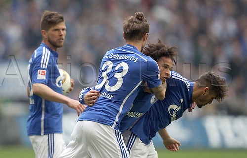 10.04.2016. Gelsenkirchen, Germany.  Schalke's Leroy Sane (2-R) celebrates his 1-1 equaliser with teammates Roman Neustaedter (front L-R) and Junior Caicara during the German Bundesliga  match between FCSchalke 04 and Borussia Dortmund at the Veltins Arena in Gelsenkirchen, Germany, 10 April 2016.