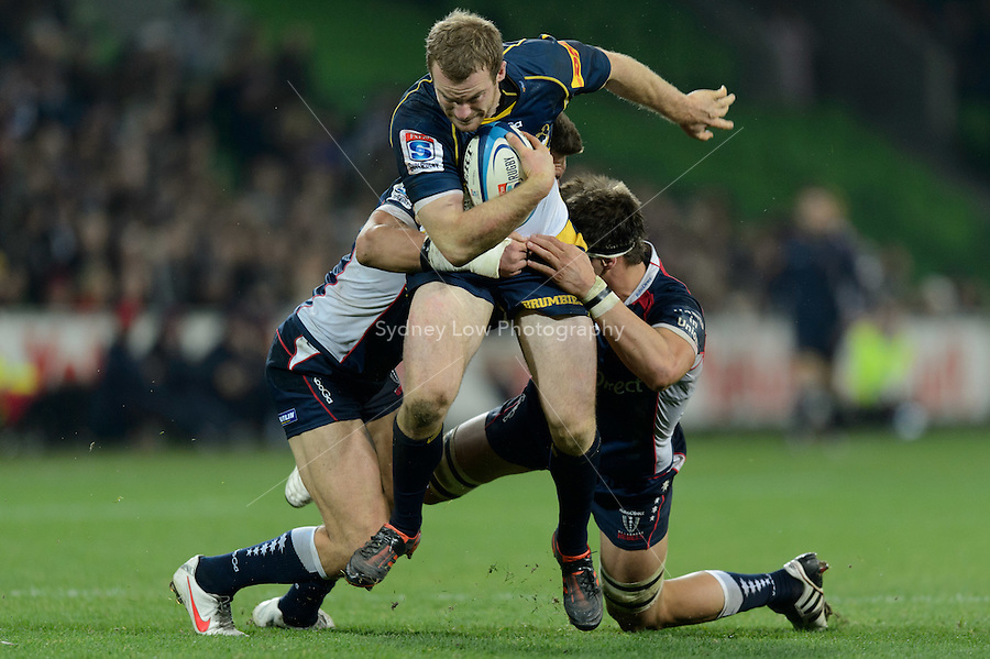 MELBOURNE, AUSTRALIA - JUNE 01: Pat McCabe of the Brumbies is tackled during round 15 of the Super Rugby match between the RaboDirect Rebels and the Brumbies at AAMI Park in Melbourne, Australia. Photo Sydney Low. Please contact ZUMA Press zumapress.com for editorial licensing.