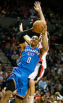APRIL 01, 2011; Portland, OR, USA;  Oklahoma City Thunder point guard Russell Westbrook (0) drives to the basket on Portland Trail Blazers shooting guard Rudy Fernandez (5) during the first quarter of the game at the Rose Garden.  Mandatory Credit: Steve Dykes-US PRESSWIRE