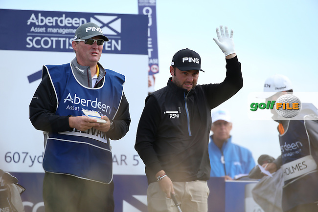 Andy Sullivan (ENG) feeling the cold during the First Round of the 2016 Aberdeen Asset Management Scottish Open, played at Castle Stuart Golf Club, Inverness, Scotland. 07/07/2016. Picture: David Lloyd | Golffile.<br /> <br /> All photos usage must carry mandatory copyright credit (&copy; Golffile | David Lloyd)