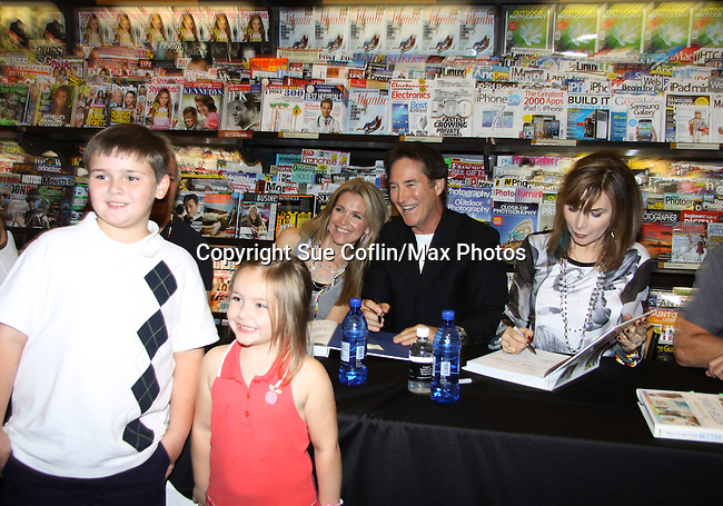 "Days Of Our Lives - Kristian Alfonso, Lauren Koslow, Melissa Reeves, Greg Vaughan, Drake Hogestyn, Wally Kurth and Greg Meng (co-executive producer and author of this book) meet the fans as they sign ""Days Of Our Lives Better Living"" on September 27, 2013 at Books-A-Million in Nashville, Tennessee. (Photo by Sue Coflin/Max Photos)"