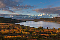 Morning light falls on Denali and the autumn tundra surrounding Wonder Lake, Denali National park, Alaska.