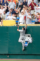 South Carolina's RF Whit Merrifield climbs the wall for Oklahoma's Caleb Bushyhead's HR in Game 3 of the NCAA Division One Men's College World Series on Sunday June 20th, 2010 at Johnny Rosenblatt Stadium in Omaha, Nebraska.  (Photo by Andrew Woolley / Four Seam Images)