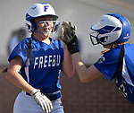 Freeburg player Elly Fischer (left) is congratulated by teammate Kelsie Burrows after she scored in the third innning. She got on by hitting a double which scored two runs. Breese Central High School played at Freeburg High School on Tuesday May 1, 2018. Tim Vizer | Special to STLhighschoolsports.com