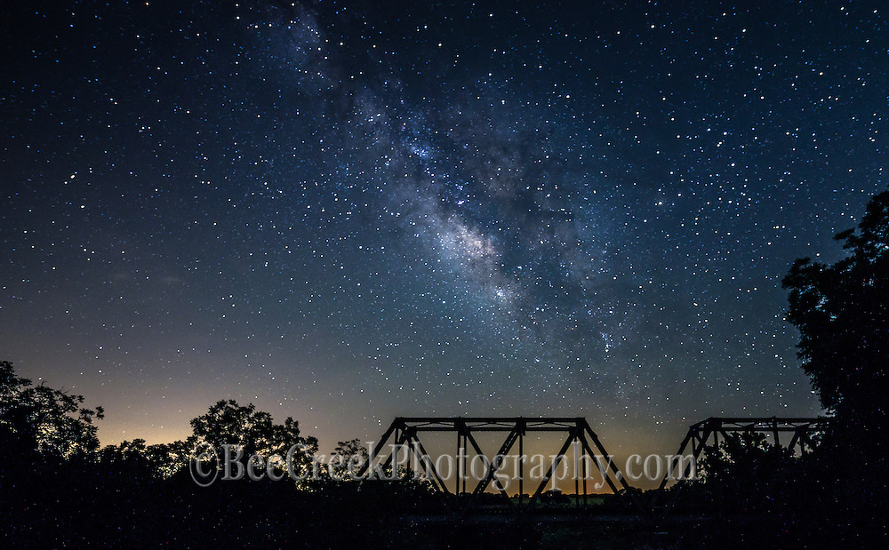Milky-way over Railroad Bridge.This is another image of the milky way as it came up over this old railroad bridge in the Texas Hill country. We used some light painting to bring out the bridge so we did not overexpose the sky. You can see the light pollution in the background from one of the near by cities. This shot took a while to find a location where we could get the a good shot of the galaxy with out too much light pollution.