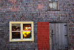 Detail of house on wharf with sunlight shining through at Peggys Cove