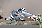 George Giboney crashes his Thunder Mustang, the Rapid Travel, during the super sport gold medal race at the 47th Annual National Championship Air Races and Air Show in Stead, Nev., on Sunday Sept. 19, 2010..(Photo by Kevin Clifford)