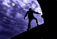 Moonlite Silhouette of man on bridge.