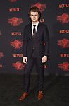 WESTWOOD, CA - OCTOBER 26: Actor Joe Keery arrives at the Premiere Of Netflix's 'Stranger Things' Season 2 at Regency Westwood Village Theatre on October 26, 2017 in Los Angeles, California.