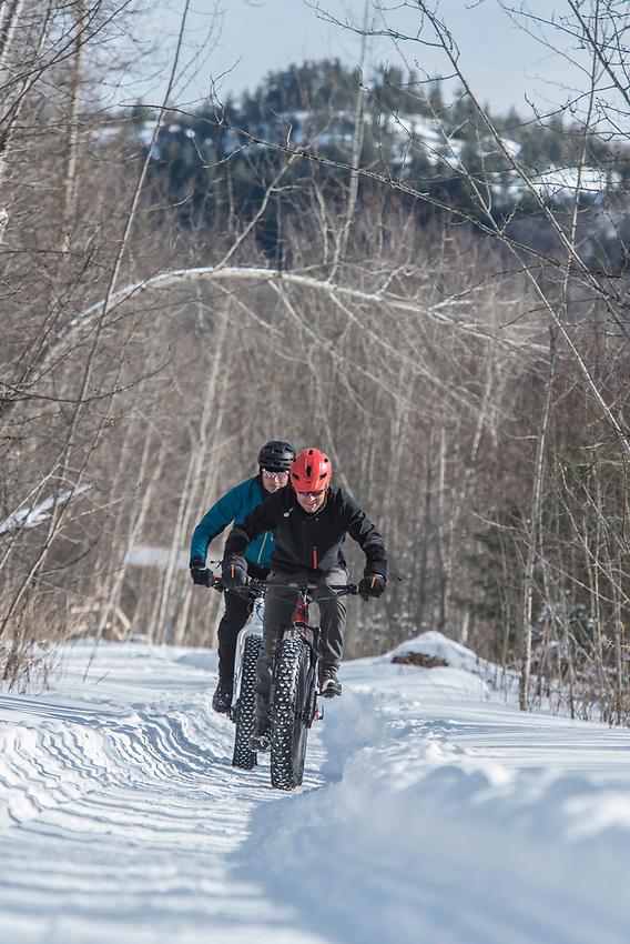 Climbing the Benson Grade trail on the Snow Bike Route of Marquette, Michigan.