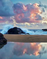 Sunrise and tide pool reflection. Kauai, Hawaii