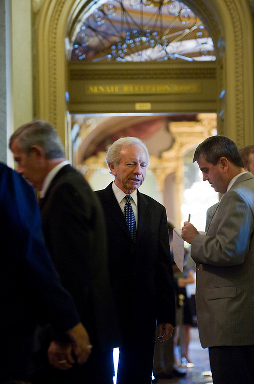 UNITED STATES - JUNE 23:  Sen. Joe Lieberman, I-Conn., is questioned by reporters before a vote in the Capitol.  (Photo By Tom Williams/Roll Call)