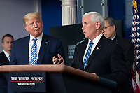 United States Vice President Mike Pence, right, speaks as US President Donald J. Trump, left, listens during a news briefing by members of the Coronavirus Task Force at the White House in Washington, DC on Monday, March 23, 2020.<br /> Credit: Chris Kleponis / Pool via CNP/AdMedia