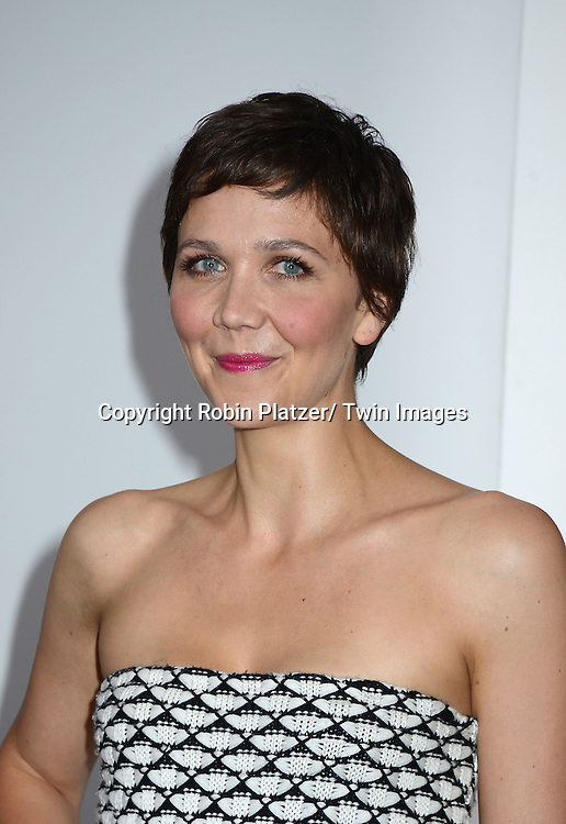 Maggie Gyllenhaal in knitted Dior dress attends the Domestic Premiere of &quot;White House Down&quot;<br /> on June 25, 2013 at the Ziegfeld Theatre in New York City. The movie stars Channing Tatum and Jamie Foxx and Maggie Gyllenhaal.