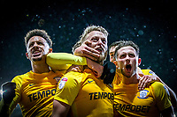 Tom Clarke of Preston North End (centre) celebrates scoring his side's winning goal with teammates during the Sky Bet Championship match between Cardiff City and Preston North End at the Cardiff City Stadium, Cardiff, Wales on 29 December 2017. Photo by Mark  Hawkins / PRiME Media Images.