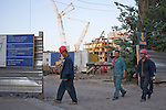 Chinese construction workers leave a huge new development in central Tiblisi at the end of their shift . The Georgian capital has a population of 1,400,000  and has seen a huge property boom, a vast renovation project and a rapidly growing economy since it's war with Russia in 2008 with the help of international funding, especially from the United States...Tiblisi June 2012.