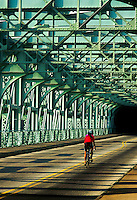 Lone biker crossing a bridge, Philadelphia, PA
