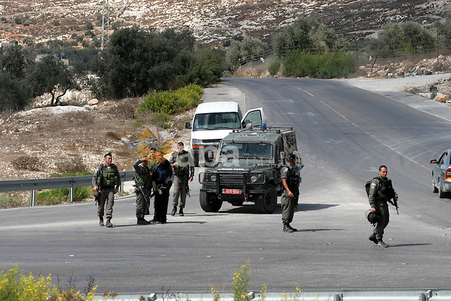 Israeli soldiers patrol streets near the village of Burqa, north of Nablus, the West Bank on Saturday, Oct. 05, 2013. following the wounding two Israeli border guards by  Palestinian driver. Locals say dozens of Israeli soldiers had been deployed near Burqa-Bizaria crossroads and had begun a wide-scale inspection in the area. Photo by Nedal Eshtayah