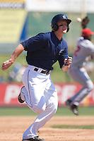 July 11, 2010: Everett AquaSox's Hawkins Gebbers (9) heads for third base during a Northwest League game against the Spokane Indians at Everett Memorial Stadium in Everett, Washington.