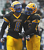 Suquan Stays #8 of Lawrence, left, gets congratulated by Keijohn Graham #44 after sacking the Wantagh quarterback in the fourth quarter of the Nassau County Conference III varsity football final at Hofstra University on Saturday, Nov. 18, 2017. Lawrence won by a score of 21-10.