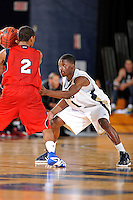21 January 2012:  FIU guard Deric Hill (1) defends FAU guard Raymond Taylor (2) in the second half as the Florida Atlantic University Owls defeated the FIU Golden Panthers, 66-64, at the U.S. Century Bank Arena in Miami, Florida.