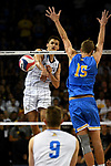 LOS ANGELES - MAY 5:  TJ DeFalco #11 of the Long Beach State 49ers spikes the ball against Jake Arnitz #15 of the UCLA Bruins during the Division 1 Men's Volleyball Championship on May 5, 2018 at Pauley Pavilion in Los Angeles, California. The Long Beach State 49ers defeated the UCLA Bruins 3-2. (Photo by John W. McDonough/NCAA Photos via Getty Images)