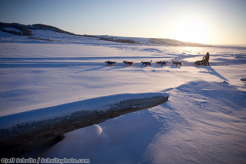 Sunday March 11, 2012  Anjanette Steer on the slough shortly after leaving Unalakleet in the morning. Iditarod 2012.