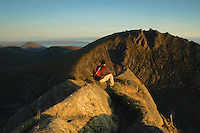 A walker looking towards Caisteal Abhail from Cir Mhor at dawn on the Isle of Arran, Ayrshire<br /> <br /> Copyright www.scottishhorizons.co.uk/Keith Fergus 2011 All Rights Reserved