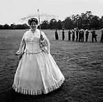 "A woman dresses in period clothing during an ""old-time"" baseball game in Delaware City, Delaware."