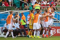 Mats Hummels of Germany celebrates scoring with his team mates on the bench a goal to make it 2-0