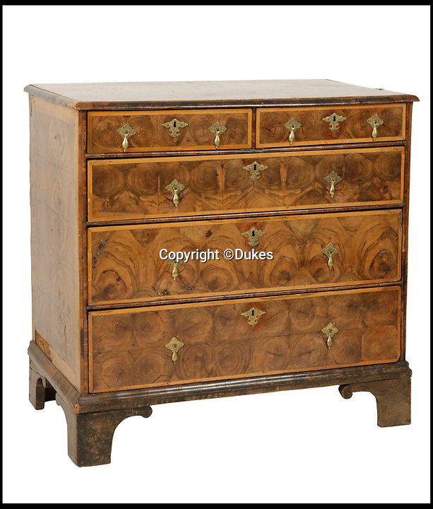 BNPS.co.uk (01202 558833)<br /> Pic: Dukes/BNPS<br /> <br /> A Queen Anne oyster walnut chest of drawers, estimated £1,000.<br /> <br /> The collection of an influential politician who helped bring Thatcher to power is going under the hammer and expected to fetch more than £86,000.<br /> <br /> More than 100 items owned by the late Sir Edward du Cann, including a rare maquette of Winston Churchill worth £50,000, have been put up for sale by his family with Duke's of Dorchester in Dorset following his death last year.<br /> <br /> Sir Edward was an MP for 31 years and the longest serving chairman of the powerful 1922 committee, where he was instrumental in bringing Margaret Thatcher to power in 1979, and his name was never far from the front pages of the national newspapers in the 1960s and 70s.<br /> <br /> Among the items being sold are several bronze sculptures of Prime Ministers Winston Churchill, Margaret Thatcher and Clement Atlee.<br /> <br /> The collection will be sold in the Dorchester saleroom on September 6.